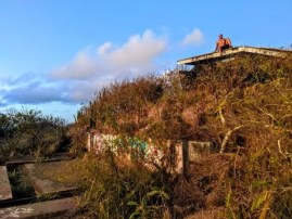 Man Living a No Hesitation Lifestyle on an abandon building in Hawaii